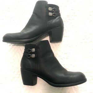 Black, winter ankle-boot wth zipper closure   .